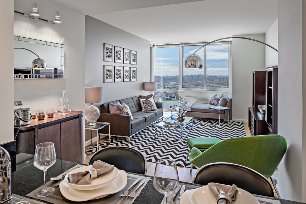 A model apartment dining room and living room at Skyline New Rochelle in New Rochelle, New York