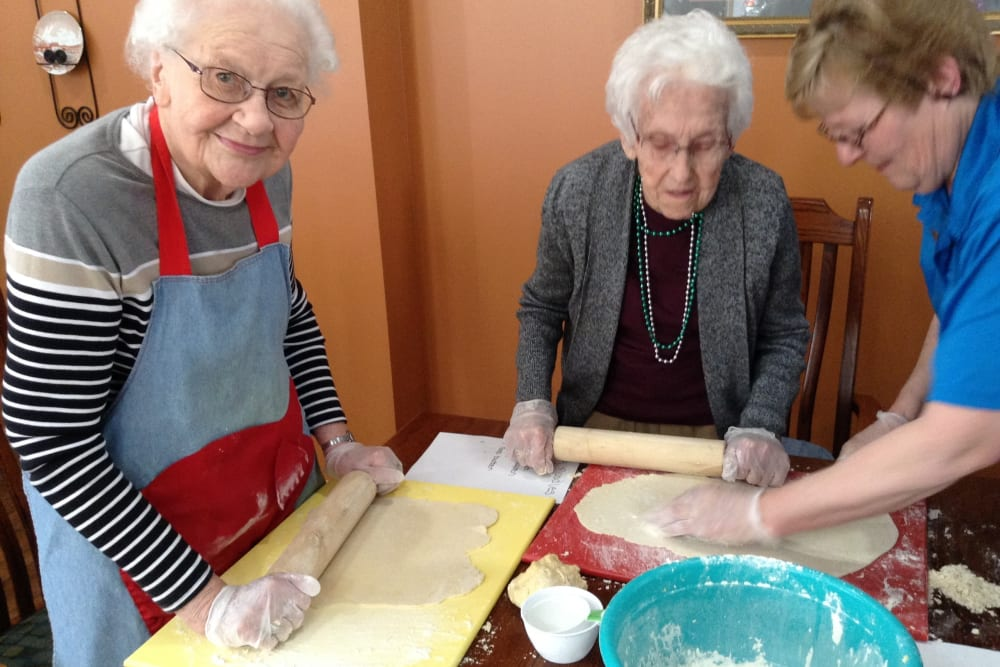 Resident baking group rolling cookie dough at Clover Ridge Place in Maquoketa, Iowa.