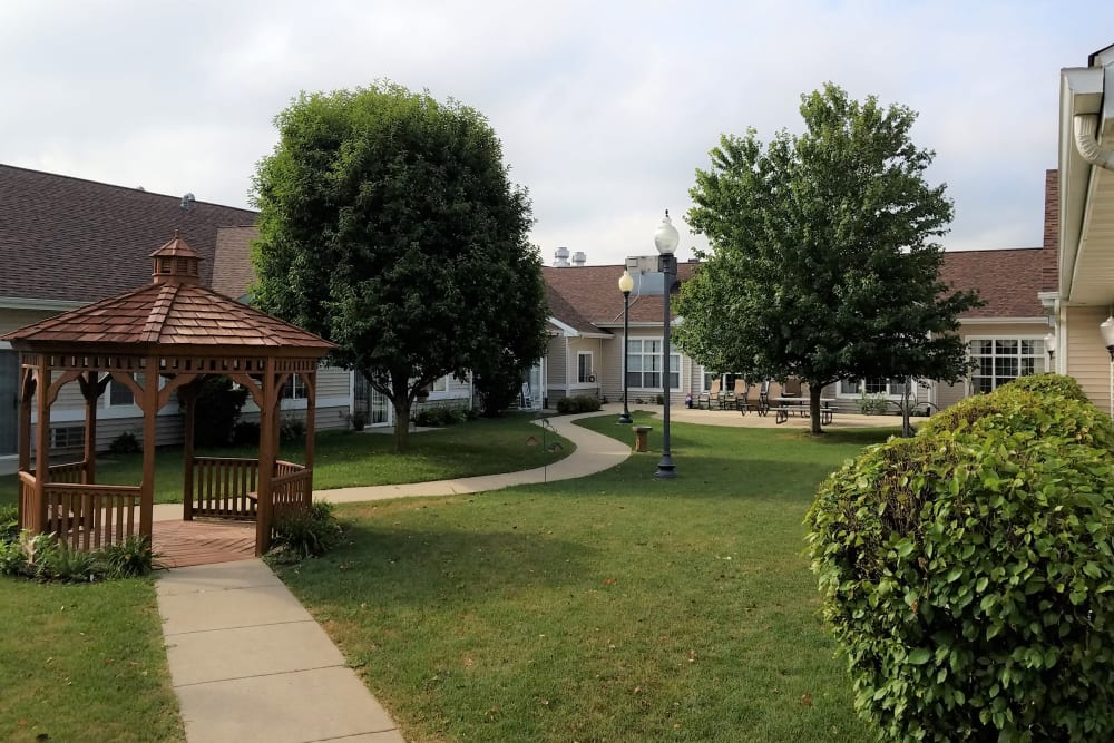 Walking path through gazebo on grounds of Clover Ridge Place in Maquoketa, Iowa.