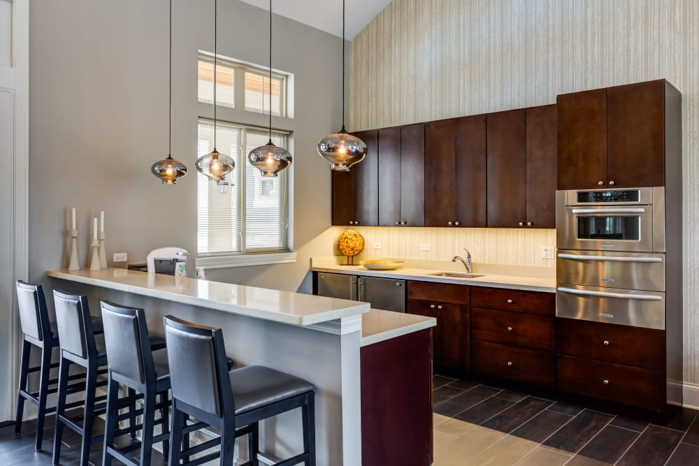 Clubhouse kitchen with bar seating for entertaining guests at The Oaks Of Vernon Hills in Vernon Hills, Illinois