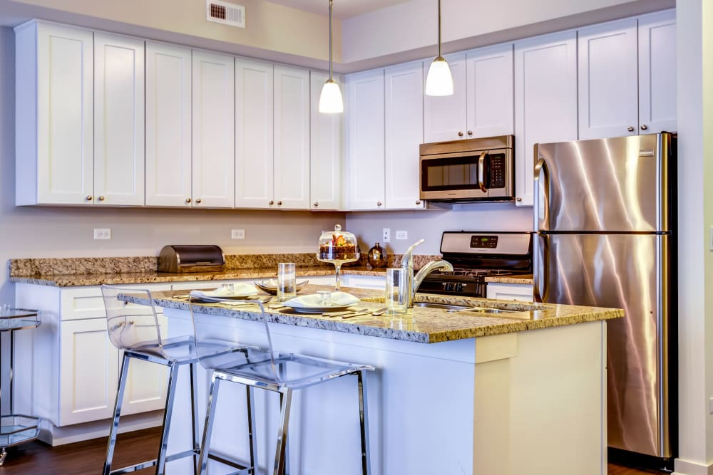 Kitchen with stainless-steel appliances and white cabinetry at The Oaks Of Vernon Hills in Vernon Hills, Illinois