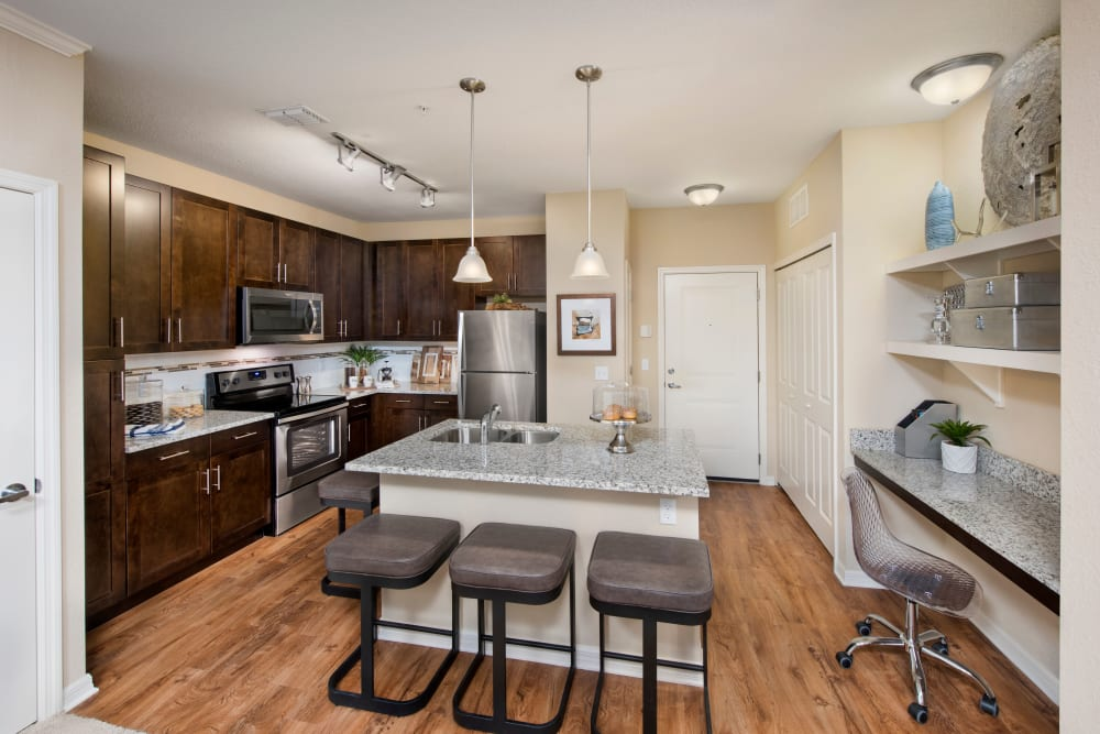 Kitchen with wood style flooring at Integra Lakes in Casselberry, Florida