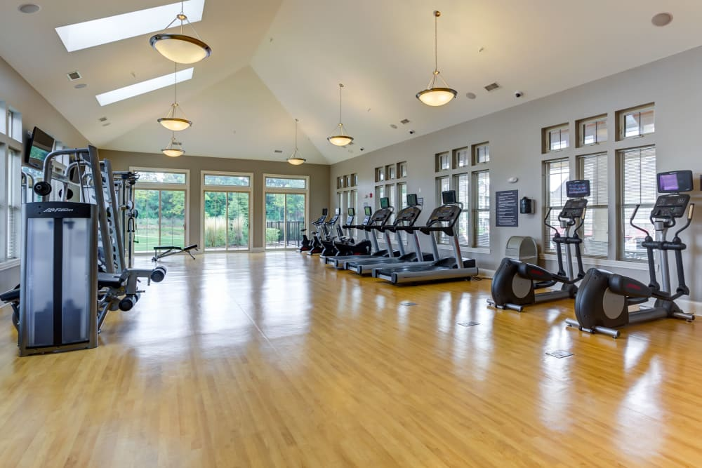 Spacious gym with lots of windows for natural lighting at The Oaks Of Vernon Hills in Vernon Hills, Illinois