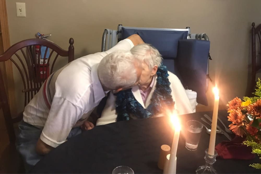 Couple enjoys candlelit Dare to Dream dinner  at Ramsey Woods in Cudahy, Wisconsin.