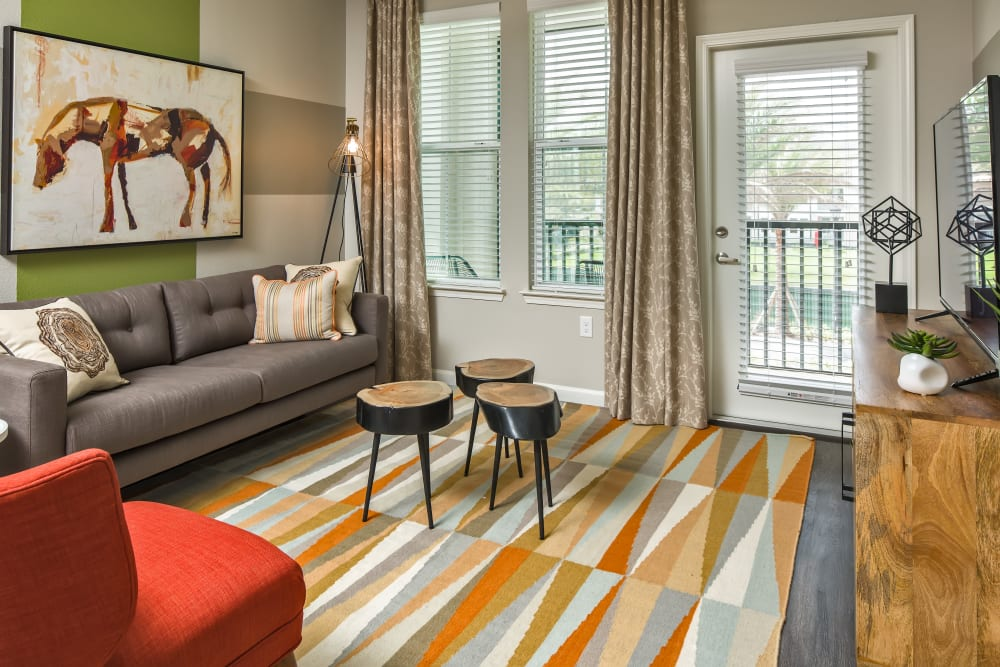 Bright, spacious living area at Linden Audubon Park in Orlando, Florida