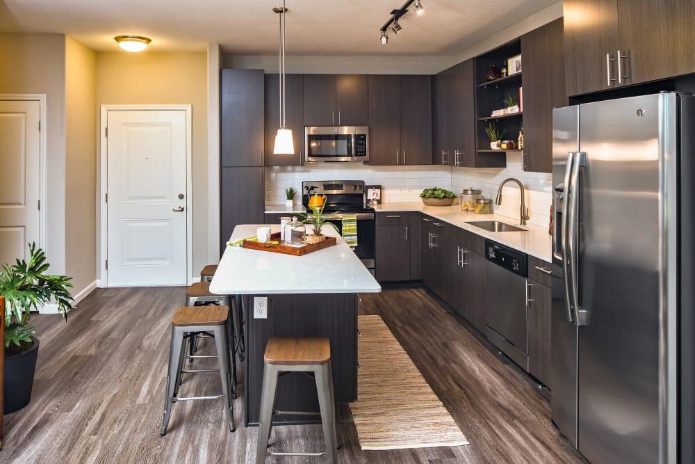 Kitchen with wood style flooring at Linden Audubon Park in Orlando, Florida