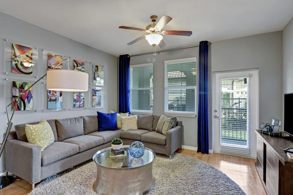 Spacious living room with patio access at Linden Pointe in Pompano Beach, Florida