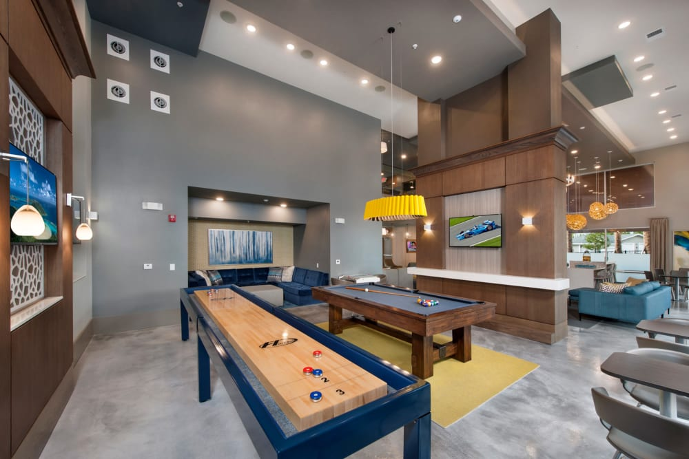 Shuffleboard in the clubhouse at Linden Crossroads in Orlando, Florida