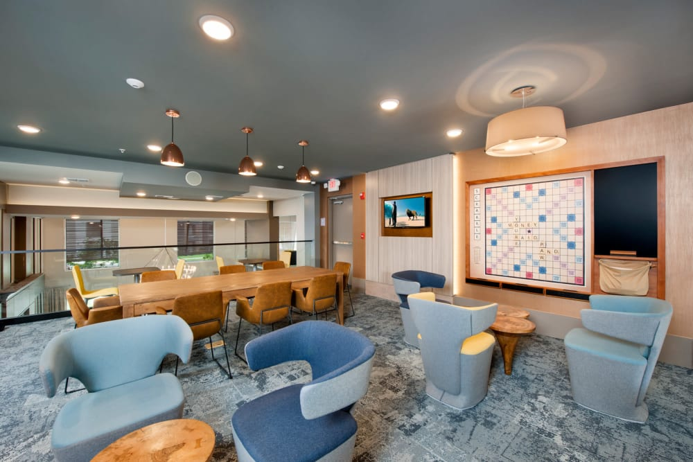 A lounge in the clubhouse with scrabble at Linden Crossroads in Orlando, Florida