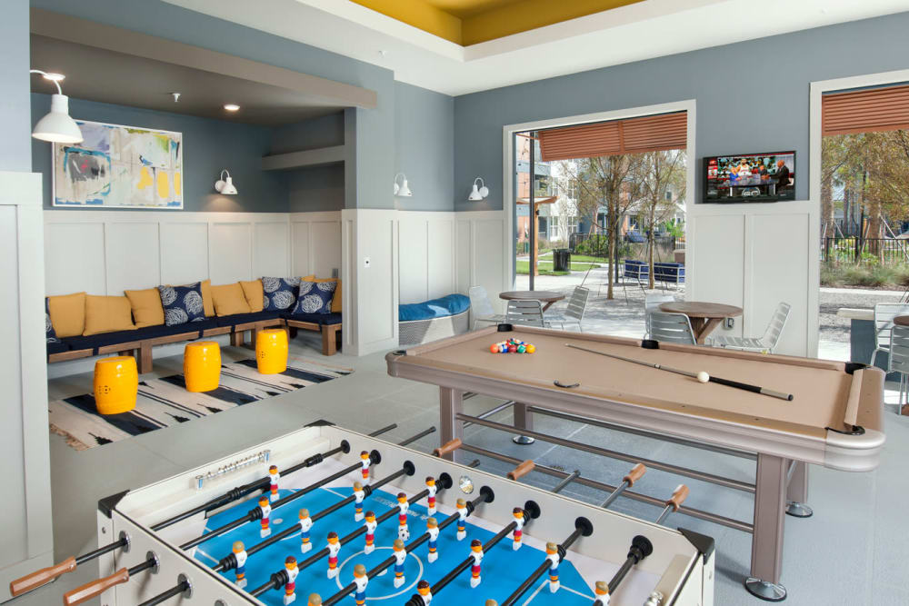 Billiards and foosball tables in Linden Crossroads's clubhouse in Orlando, Florida