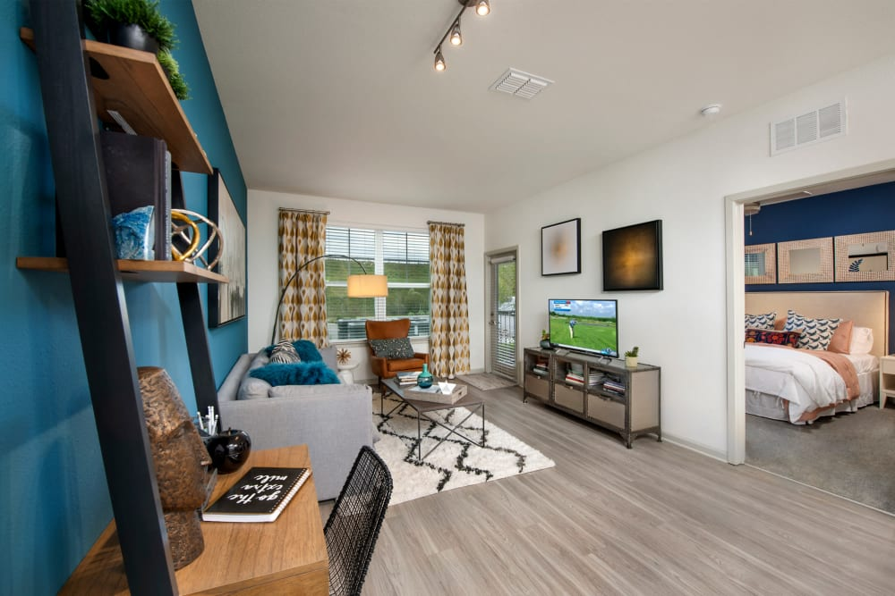 Wood flooring in an apartment living room and bedroom at Linden Crossroads in Orlando, Florida