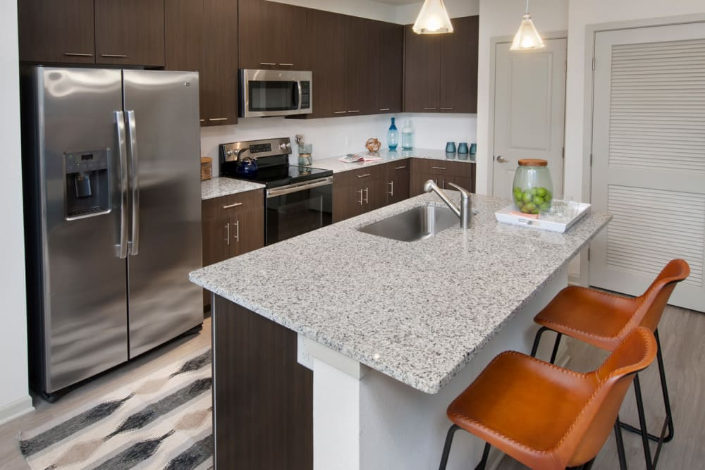 A gourmet kitchen prep island in a model apartment at Linden Crossroads in Orlando, Florida
