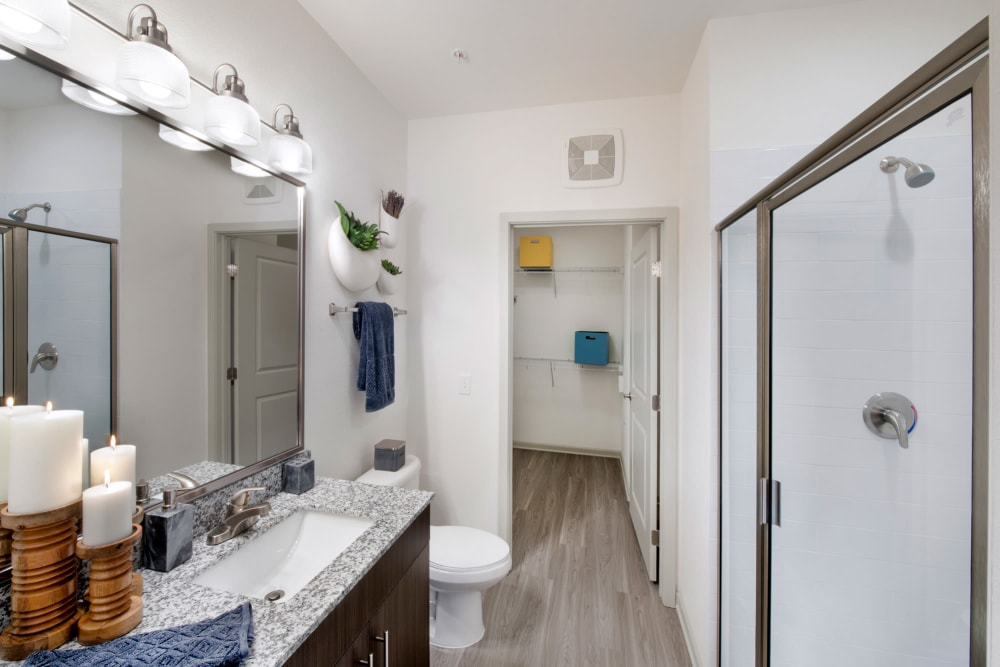 A model bathroom with attached walk-in closet at Linden Crossroads in Orlando, Florida