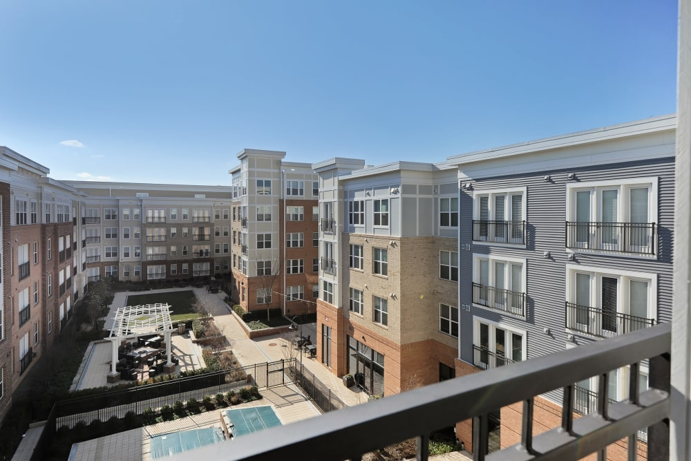 Courtyard with pool and grilling areas at The Mark at Brickyard Apartment Homes in Beltsville, Maryland