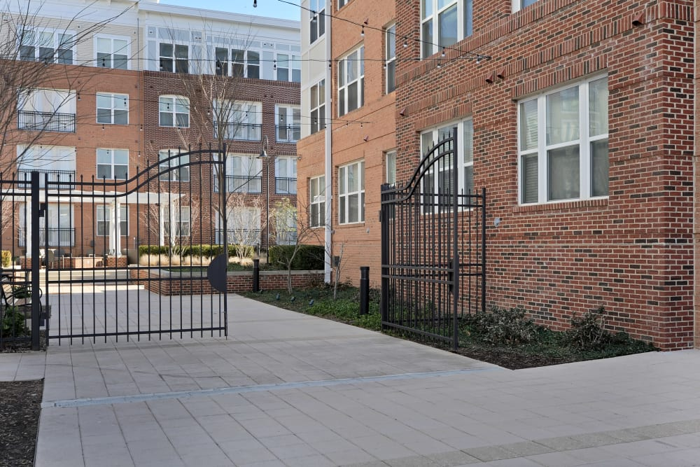 Gate to courtyard at The Mark at Brickyard Apartment Homes in Beltsville, Maryland.
