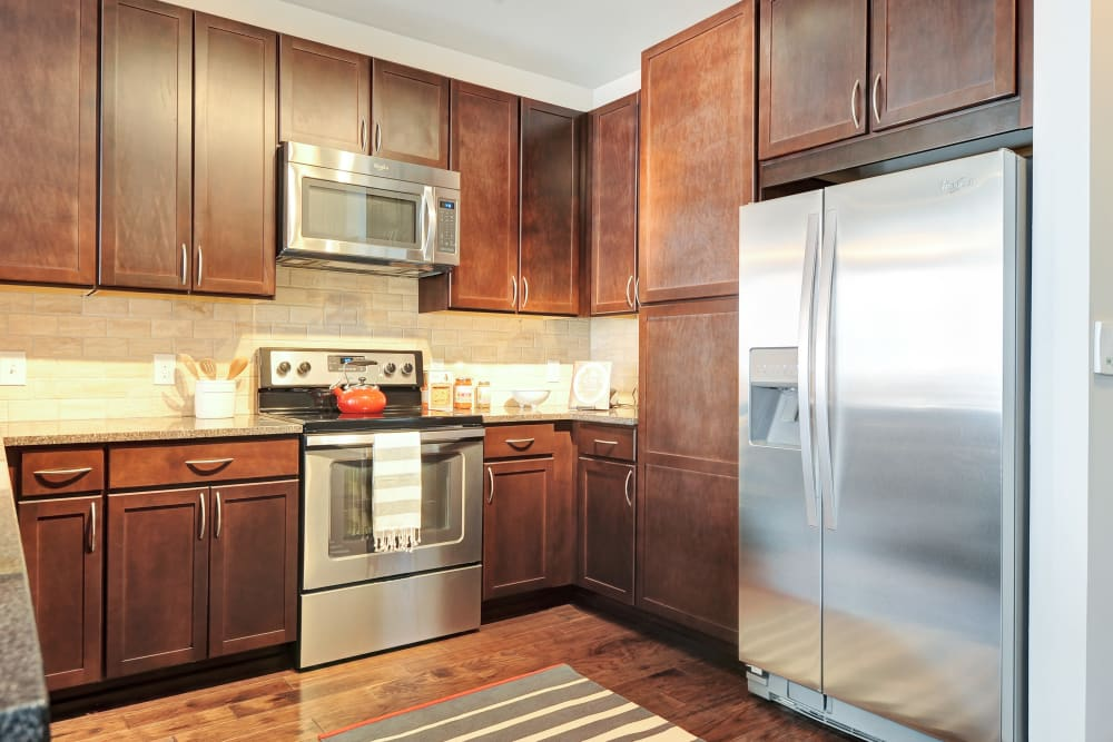 Kitchen with stainless steel appliances at The Mark at Brickyard Apartment Homes in Beltsville, Maryland