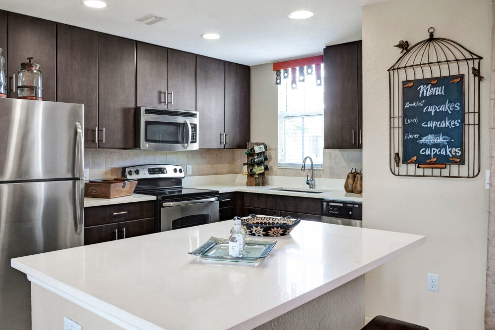 Granite inspired counter tops in an apartment kitchen at City Center on 7th Apartment Homes in Pembroke Pines, Florida