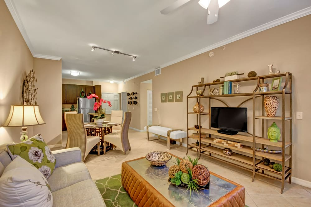 A model apartment living room and kitchen at City Center on 7th Apartment Homes in Pembroke Pines, Florida