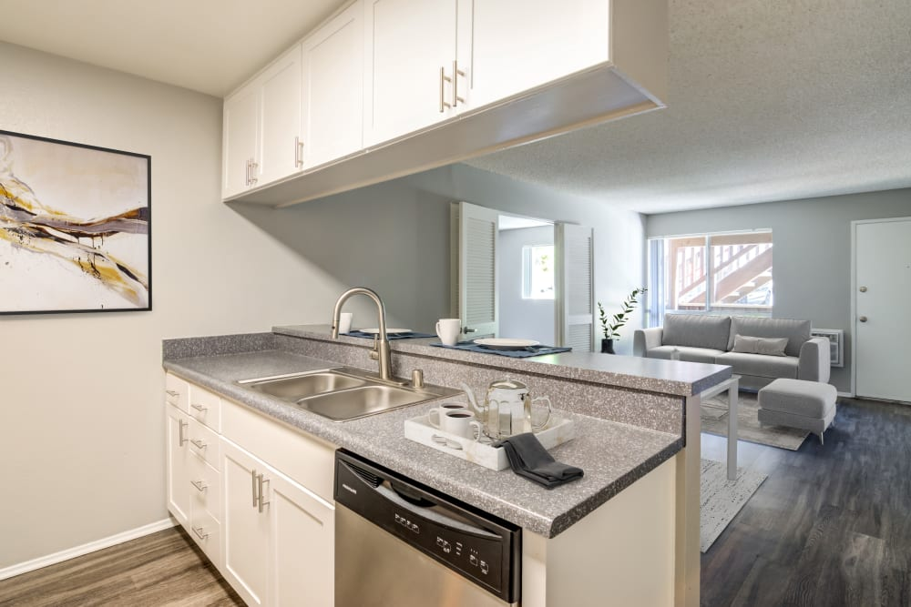 A kitchen with plenty of cabinet space at Hillside Terrace Apartments in Lemon Grove, California