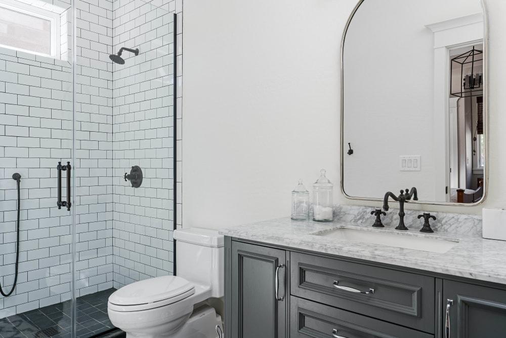 Custom tiled shower in the master bathroom of a model apartment at El Potrero Apartments in Bakersfield, California