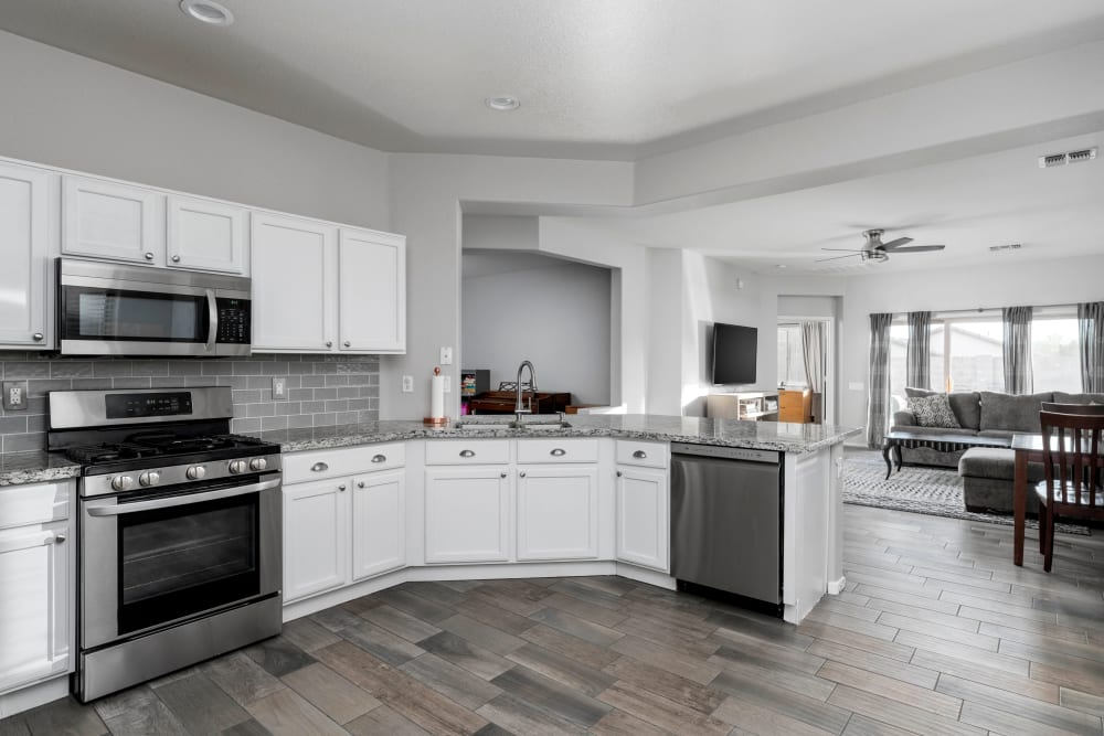 Hardwood flooring in the open-concept kitchen of a model home at El Potrero Apartments in Bakersfield, California