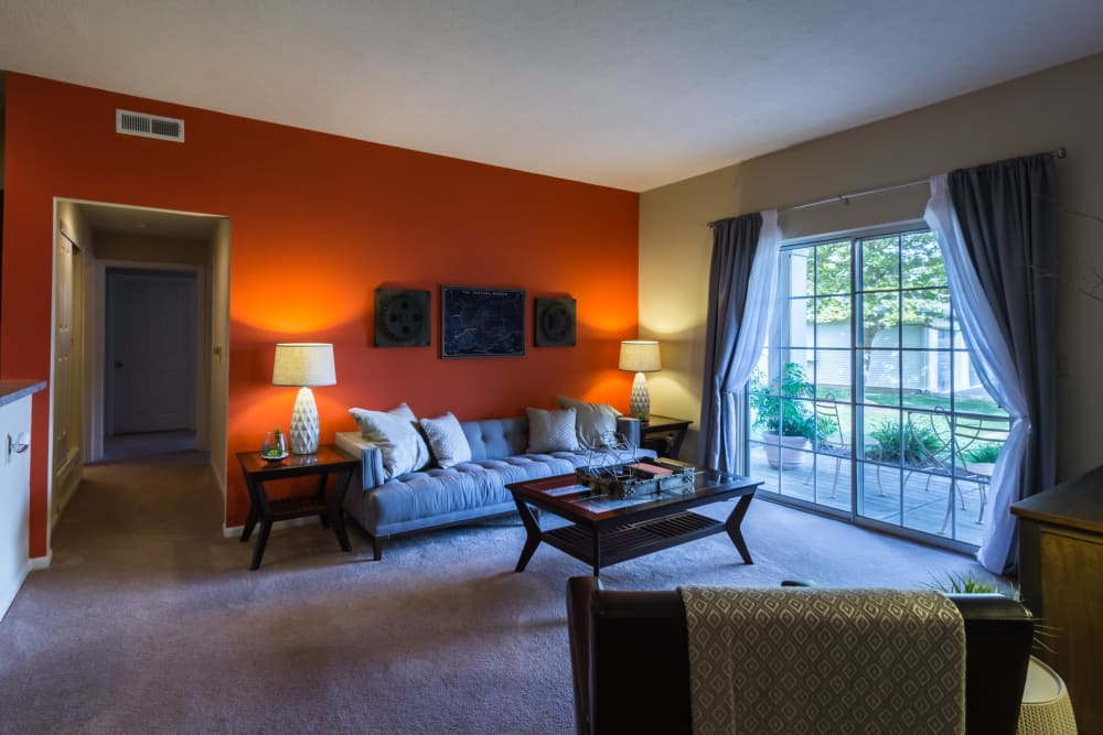 A spacious apartment living room at Alexander Court in Reynoldsburg, Ohio