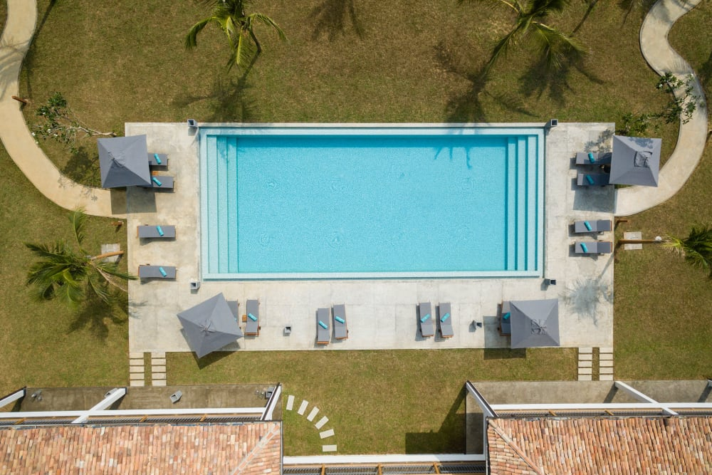 Aerial view of the swimming pool area at El Potrero Apartments in Bakersfield, California