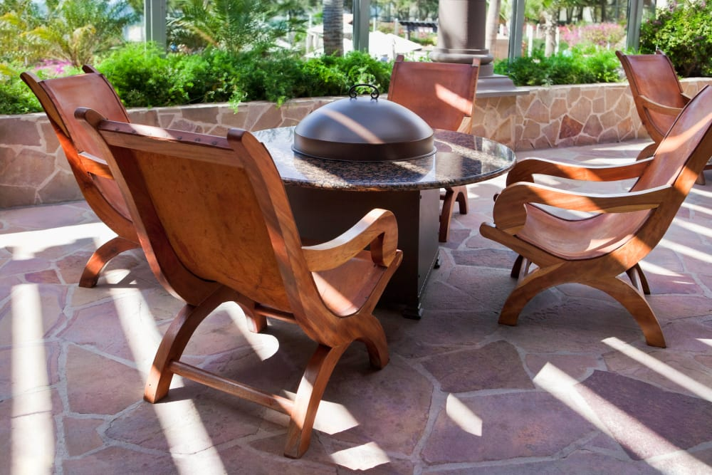Comfortable seating around the fire pit at El Potrero Apartments in Bakersfield, California