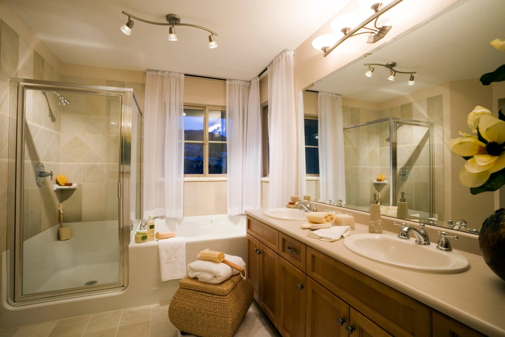 Spacious master bathroom in a model home at Highland View Court in Bakersfield, California