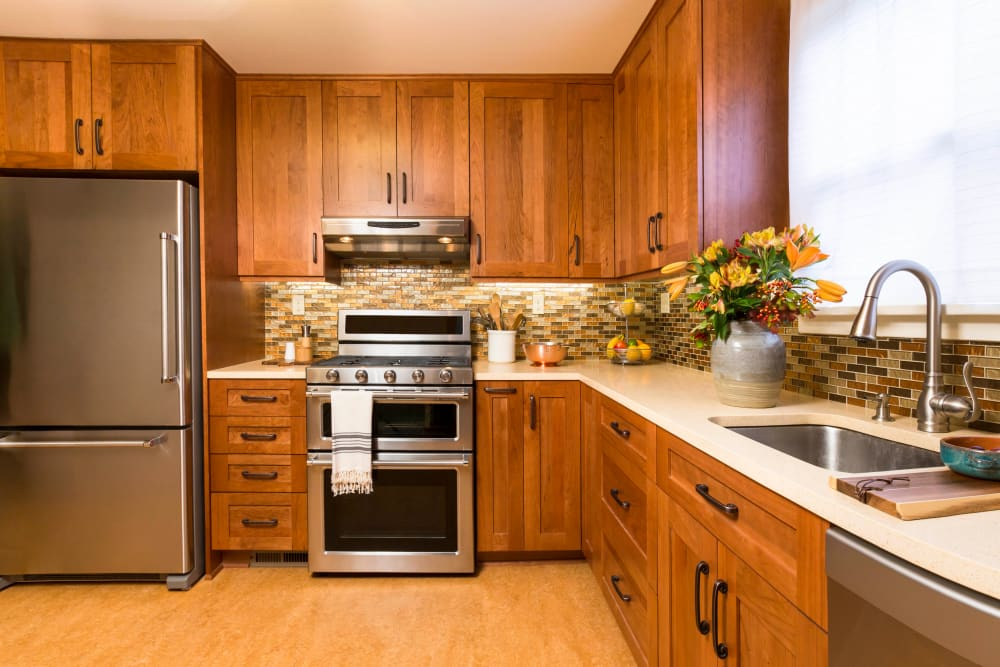 Stainless-steel appliances in a model apartment's kitchen at Highland View Court in Bakersfield, California