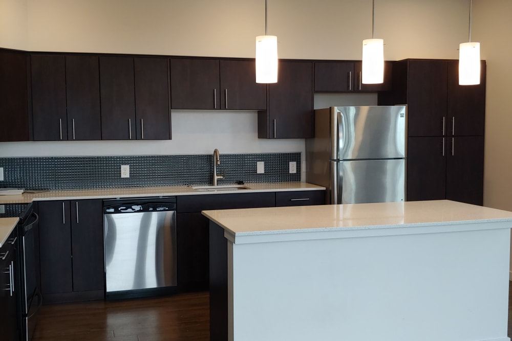 Dark wood kitchen at South Block Apartments in Salem, OR