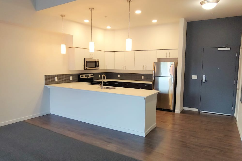 View of the kitchen from the living room at South Block Apartments in Salem, OR