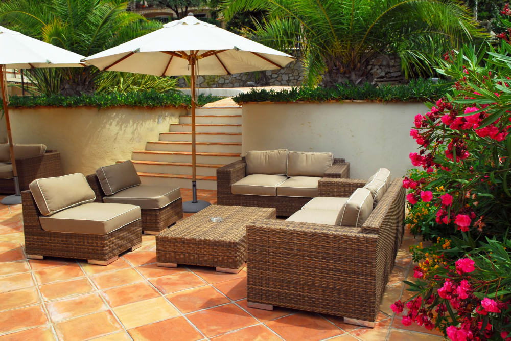 Shaded seating at an outdoor lounge area at Highland View Court in Bakersfield, California