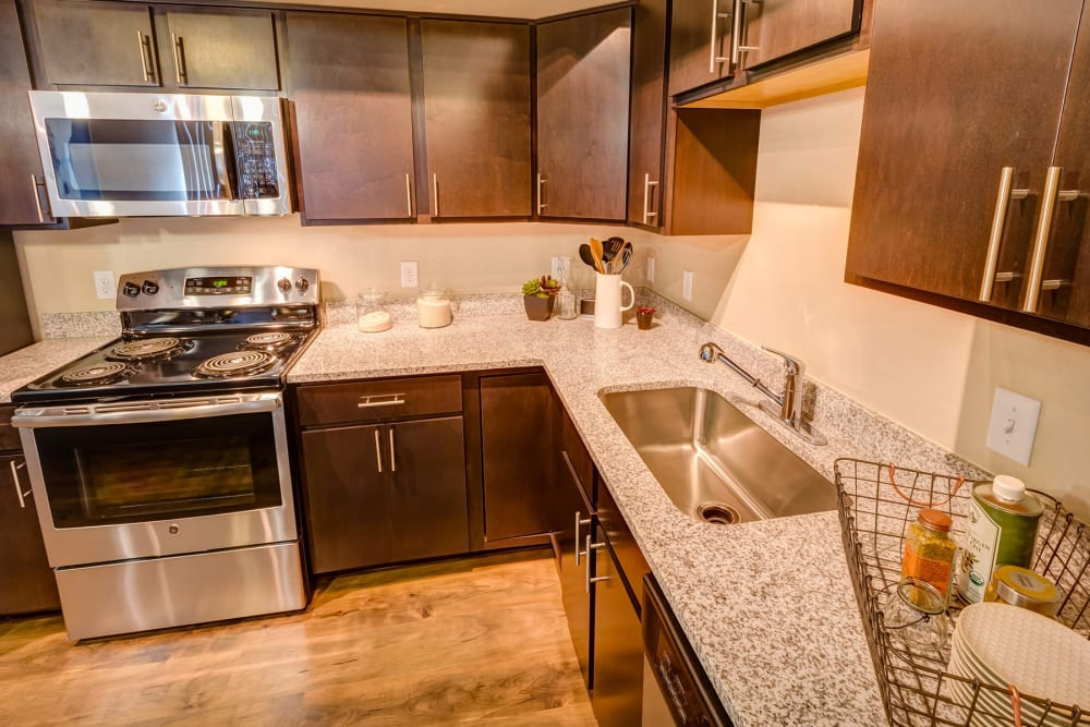 Gourmet kitchen with granite countertops in a model home at Granite 550 in Casper, Wyoming