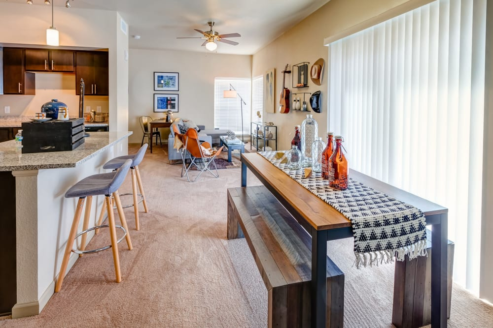 Spacious and well-furnished open-concept floor plan in a model home at Granite 550 in Casper, Wyoming