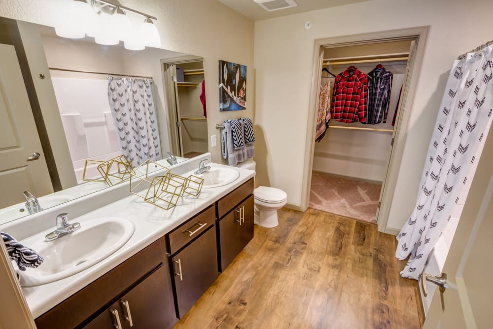 Hardwood flooring in a model apartment's bathroom at Granite 550 in Casper, Wyoming