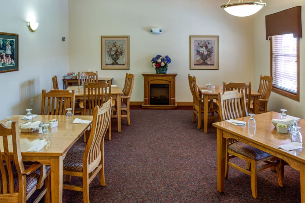 Small dining room with fireplace at Prairie Hills in Clinton, Iowa.