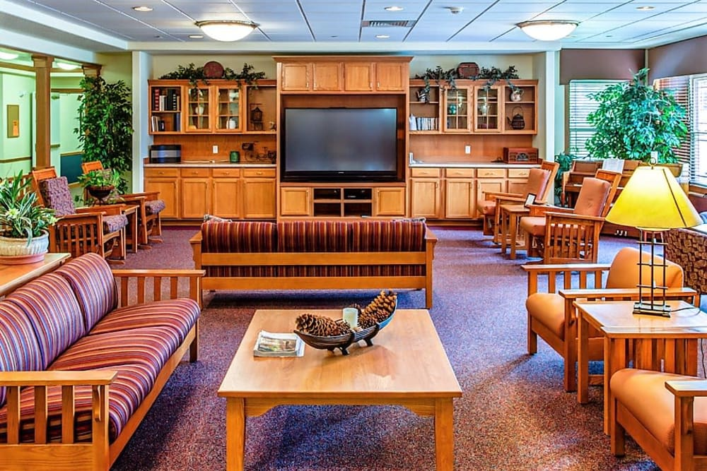 Resident lounge with big screen TV at Prairie Hills in Clinton, Iowa.