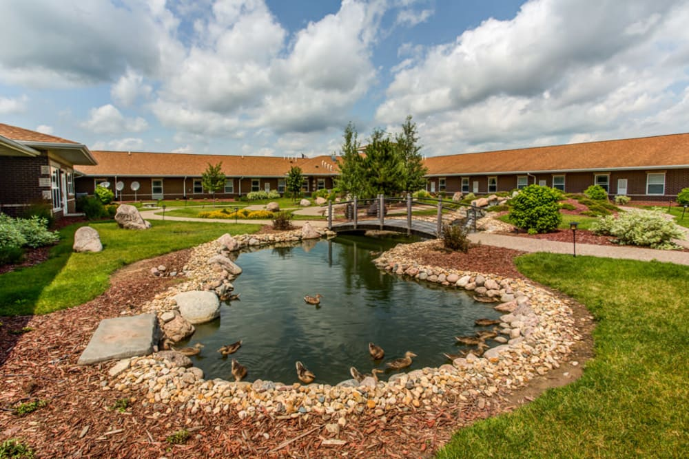 Lush landscaping and pond at Prairie Hills in Clinton, Iowa.
