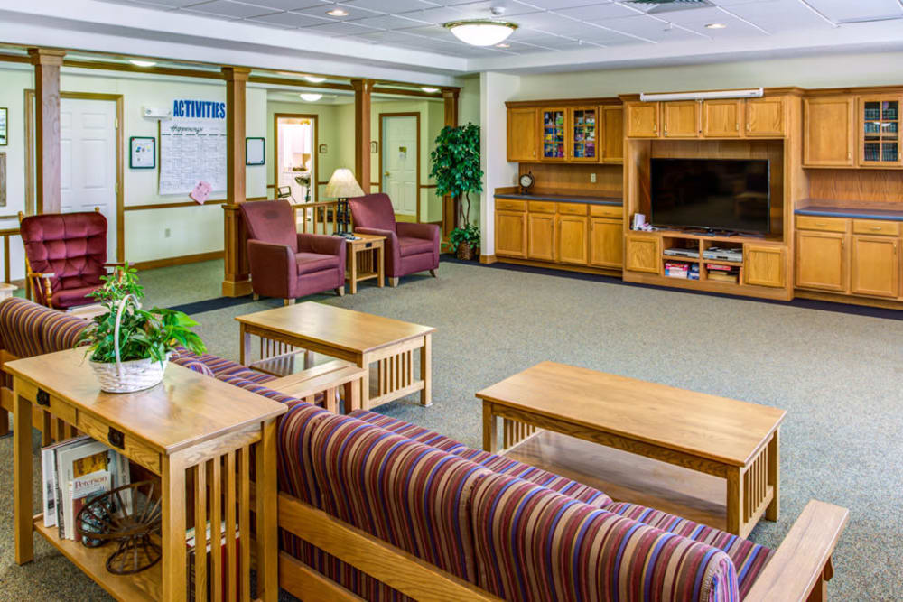 Spacious activity room with big screen TV at Prairie Hills in Independence, Iowa.