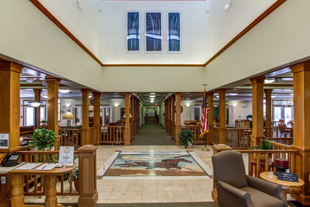 Inviting lobby with mosaic at Prairie Hills Independence in Independence, Iowa.