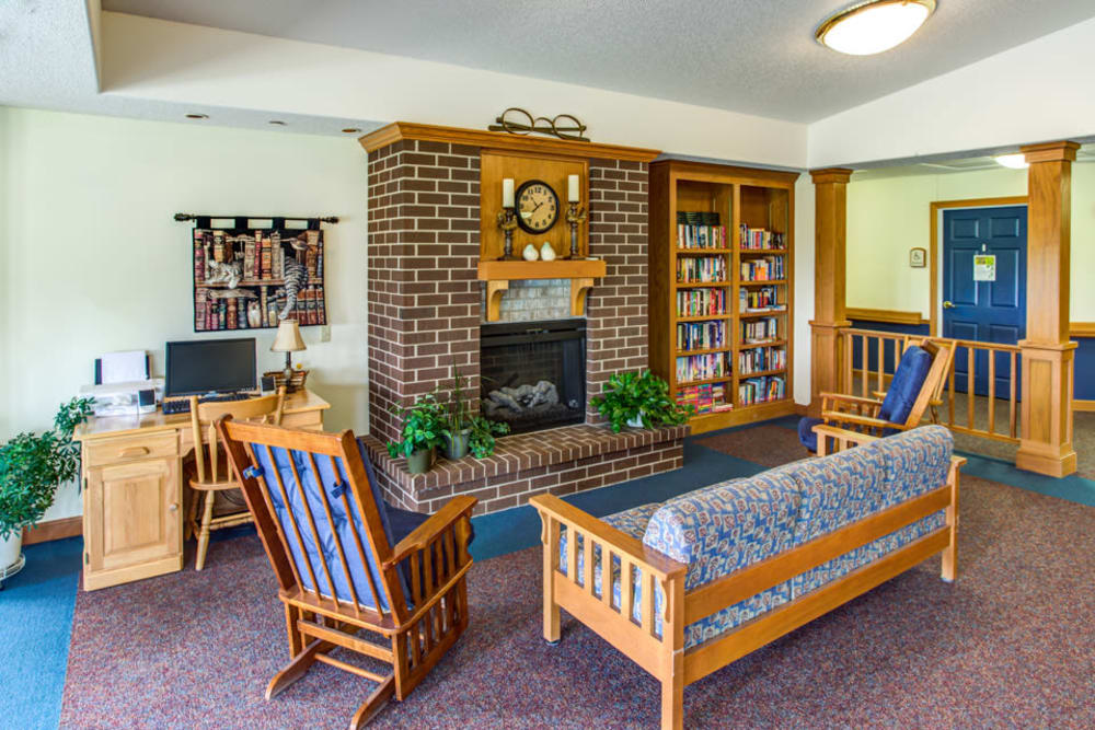 Comfortable lounge seating around a fireplace at Prairie Hills in Independence, Iowa.