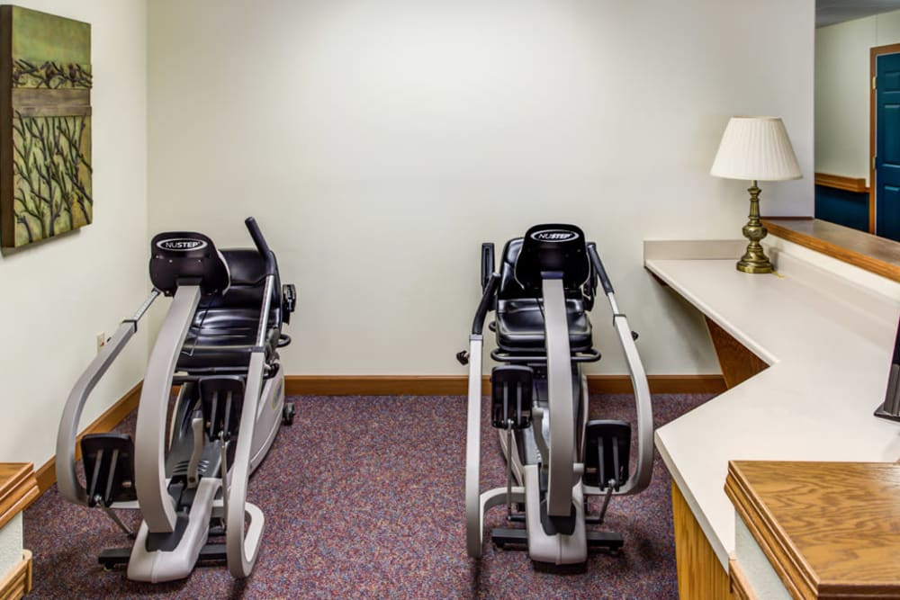 Resident exercise room with equipment at Prairie Hills Independence in Independence, Iowa.
