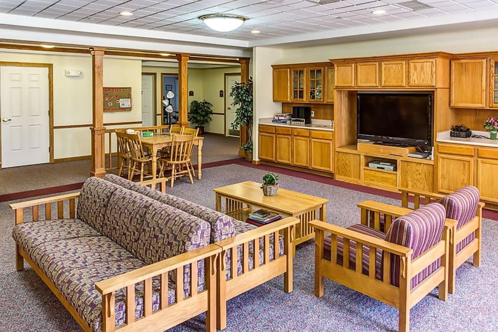 Spacious community room with big screen TV at Prairie Hills in Tipton, Iowa.