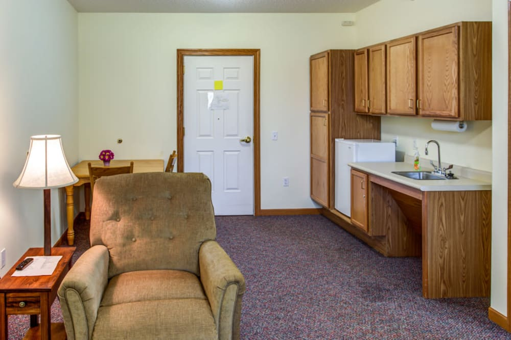 Cozy living room and kitchenette at Prairie Hills in Tipton, Iowa.
