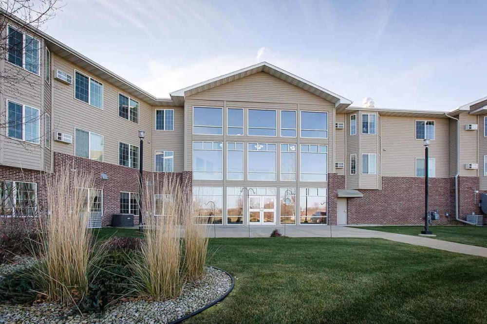 Courtyard and rear entrance at Prairie Meadows Senior Living in Kasson, Minnesota.