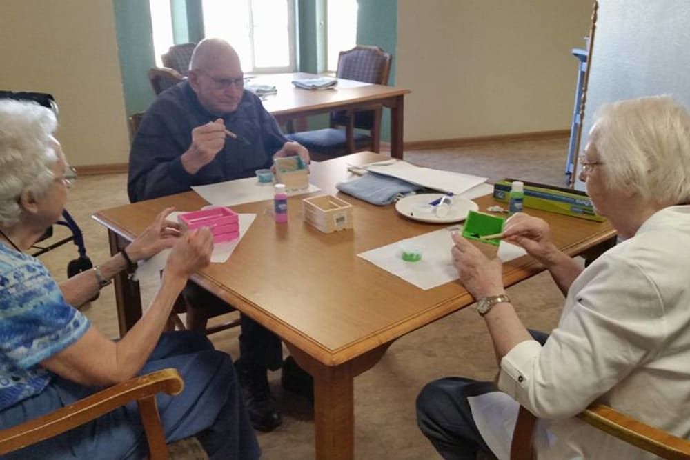 Crafting together in an activity room at Prairie Meadows Senior Living in Kasson, Minnesota.