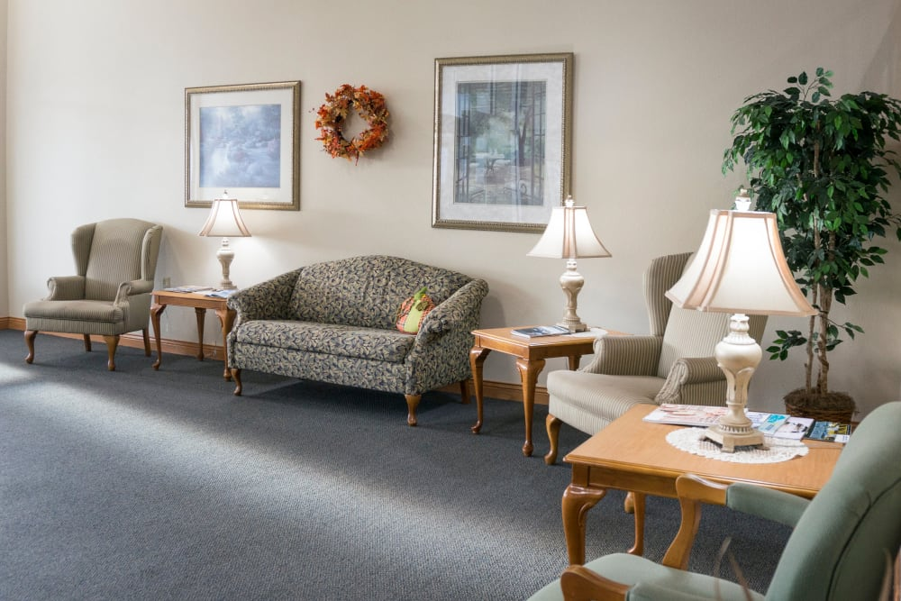 Spacious entry lounge with wall art at Prairie Meadows Senior Living in Kasson, Minnesota.