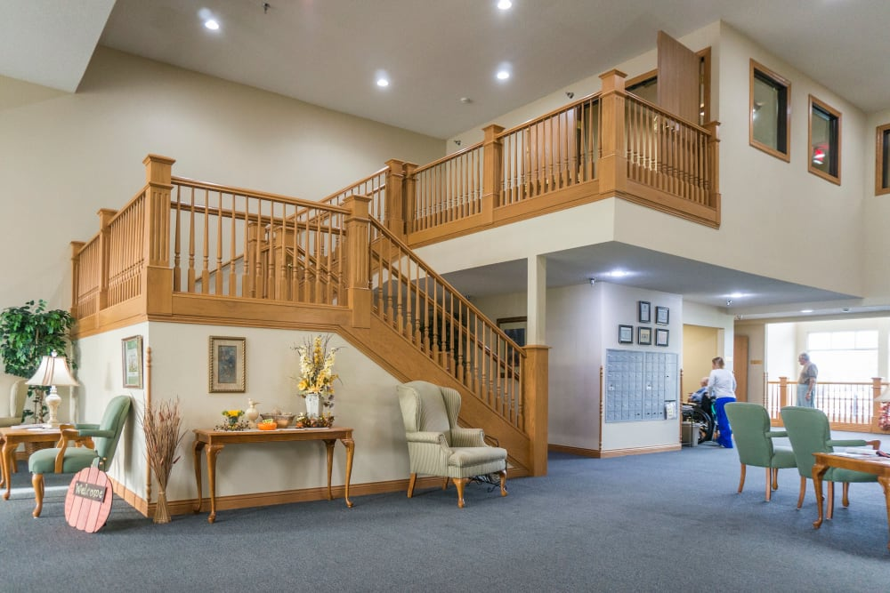 Grand staircase in lobby of Prairie Meadows Senior Living in Kasson, Minnesota.