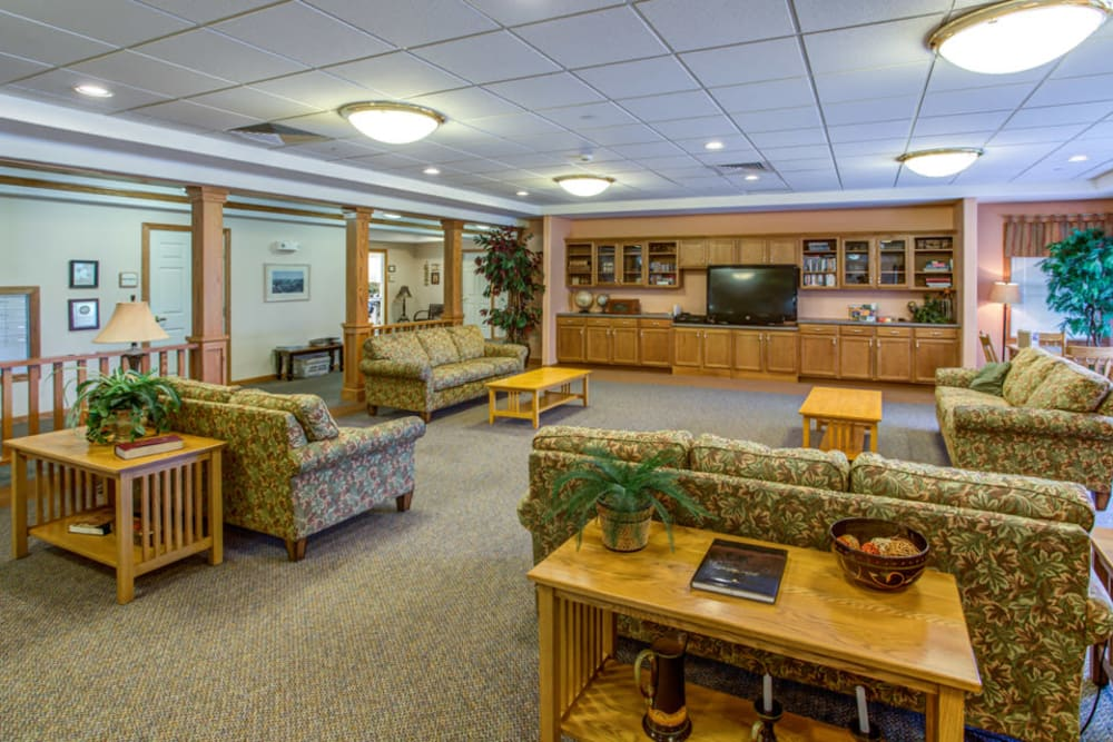 Spacious community room with TV at SunnyBrook Carroll in Carroll, Iowa.